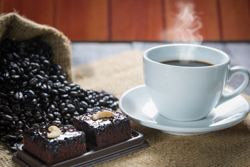 Coffee cup and coffee beans with brownie