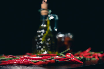 olive oil in blur and chilli on black