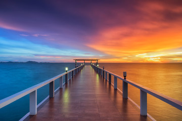 Wooden pier between sunset