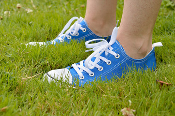 sneakers and grass