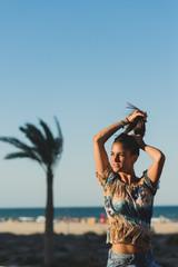 Pretty woman makes a tail against seashore