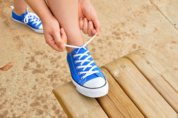 adjusting the laces of shoes