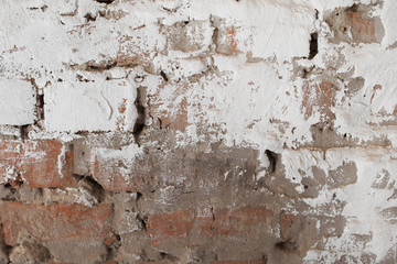 Fotobehang Oude vuile getextureerde muur Old brick wall with plaster background. Fragment of outdoor side of damaged building with white and gray cement