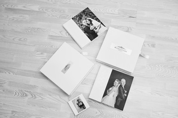 Set of wedding albums and wedding books at wooden background