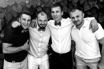 Handsome groom with his friends outdoors