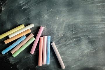 Empty blank black chalkboard with chalk traces