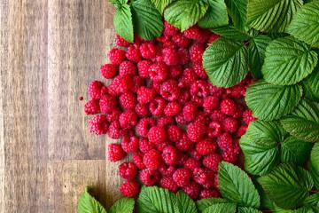 raspberries and green leaves