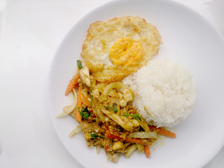 Stir fried mixed vegetables with yellow curry & thai jasmine rice on white plate isolate on white background. Vegetarian Food, Healthy food.