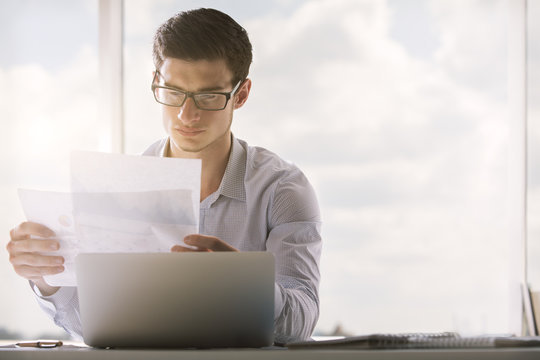 Man looking at business report