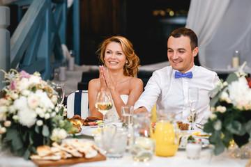 Young beautiful stylish smiling newlyweds