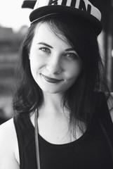 hipster girl in cap closeup, brunette outdoors,