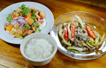 boiled rice eat with spicy egg salad and stir fried Indian mushroom on table