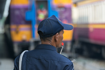 Thai railway train with Security man