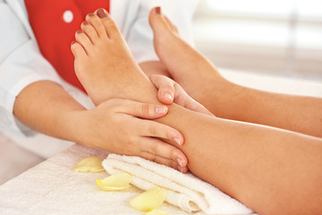 Woman having spa massage at salon