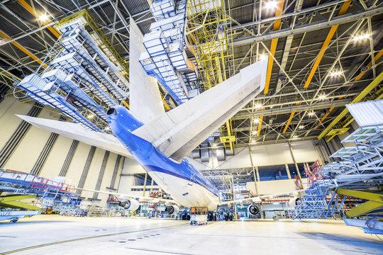 Refurbishment of an airplane in a hangar.