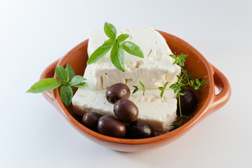 Feta cheese on brown plate