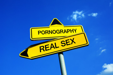 Pornography vs Real Sex - Traffic sign with two options -  appeal to fight against exaggerated pornographic material and risk of addiction and unrealistic expectation about reality and sex life