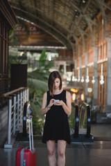 Adorable girl using smartphone