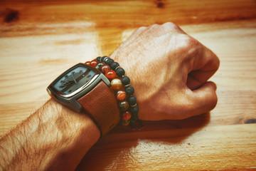 fashion men, wrist watch, bracelet, volcanic stone bracelet stone agate. Male hand. Vintage style