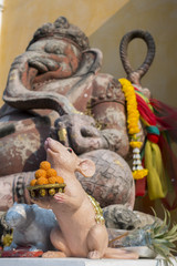 Statue of the hinduist god Ganesha and musaka stutue in public temple in Thailand, Ganesha God is elephant God in Hindu religion.
