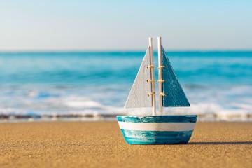 toy sailboat at the seashore Wall mural