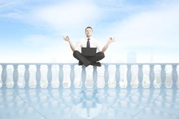 Man meditating on balcony pillars