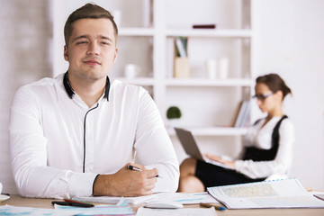 Thoughtful man doing paperwork