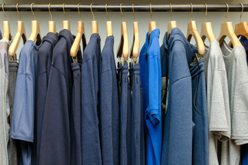 Various Men's Clothing On A Wooden Hanger