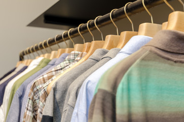 Various Men's Clothing On A Wooden Hanger. CloseUp shot with small GRIP.