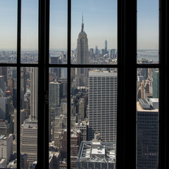 Looking out a window at the skyscrapers in Manhattan, New York City