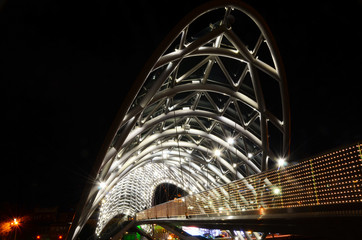 Famous Glass made Peace Bridge on river Mtkvari. Tbilisi Georgia