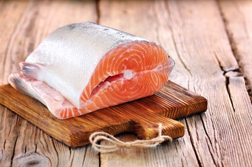 Wild salmon on the old wooden background.