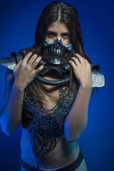girl with iron armor and metal skull, sensual dark and dangerous