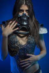 pretty girl with iron armor and metal skull, sensual dark and da