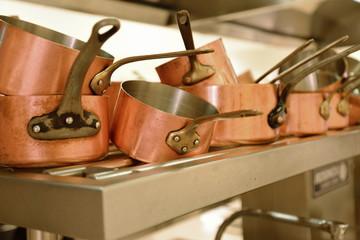 preparing dinner in restaurant kitchen
