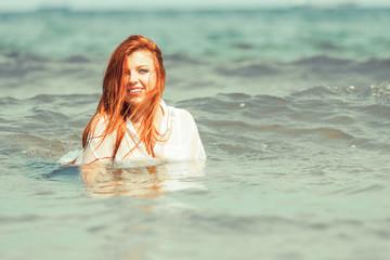 Girl relaxing in sea water