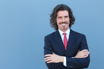 Fashionable businessman with long wind blown hair
