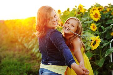 Girls in sunflower field doing the tango