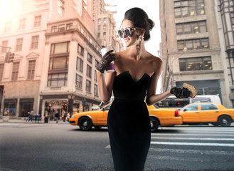 Woman in fashionable long dress walking in the street