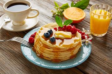 pancakes breakfast syrup coffe and orange juice