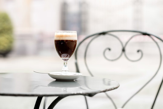 Bicerin traditional Italian coffee made of espresso, chocolate and whole milk served layered in a rounded glass invented in Turin city