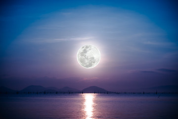 Romantic scenic with full moon on sea to night. Reflection of moon