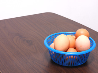 boiled eggs was placed in the blue basket - some broken