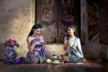 Two beautiful Thai girl in Thai traditional costume