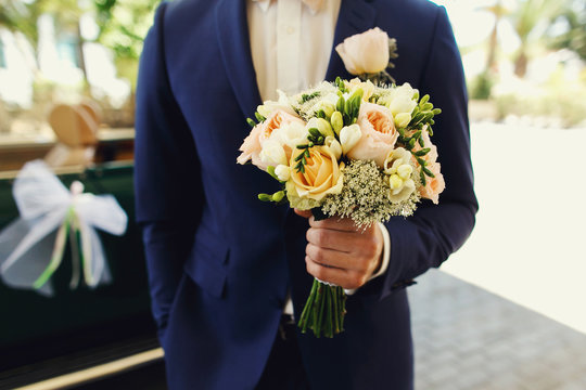 Self confident groom in a blue suit