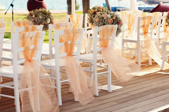 A lot of wedding chairs and luxurious tent
