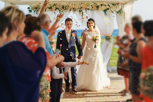 Stylish happy smiling newlyweds