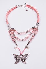 Baby pink necklace with a silver butterfly pendant