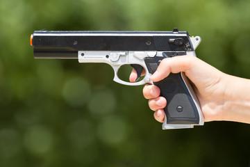 Hand with a laser gun