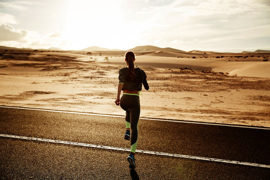 girl running in sunset
